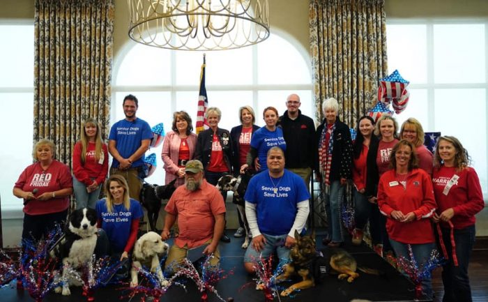 Fairway employees at an AWI event with five dogs